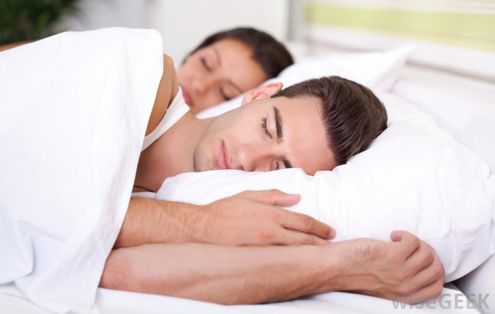 Man And Woman Sleeping White Bed